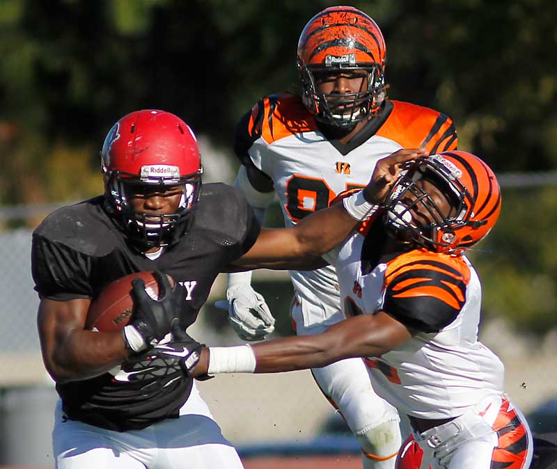 Running back Nick Birdsong (3) battles against Treshon Broughton (2) in Chaffey's home game against Riverside City College on Nov. 8, 2014.
