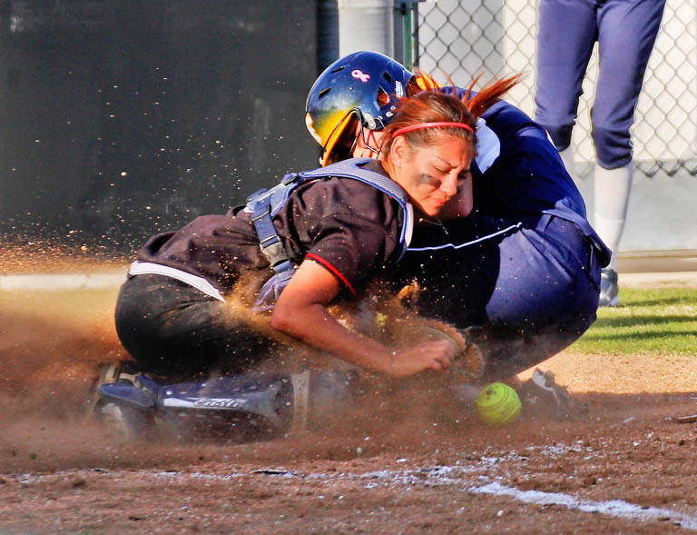 Chaffey catcher Jacqueline Valadez attempts to out a sliding Rio Hondo player at Chaffey on April 9.