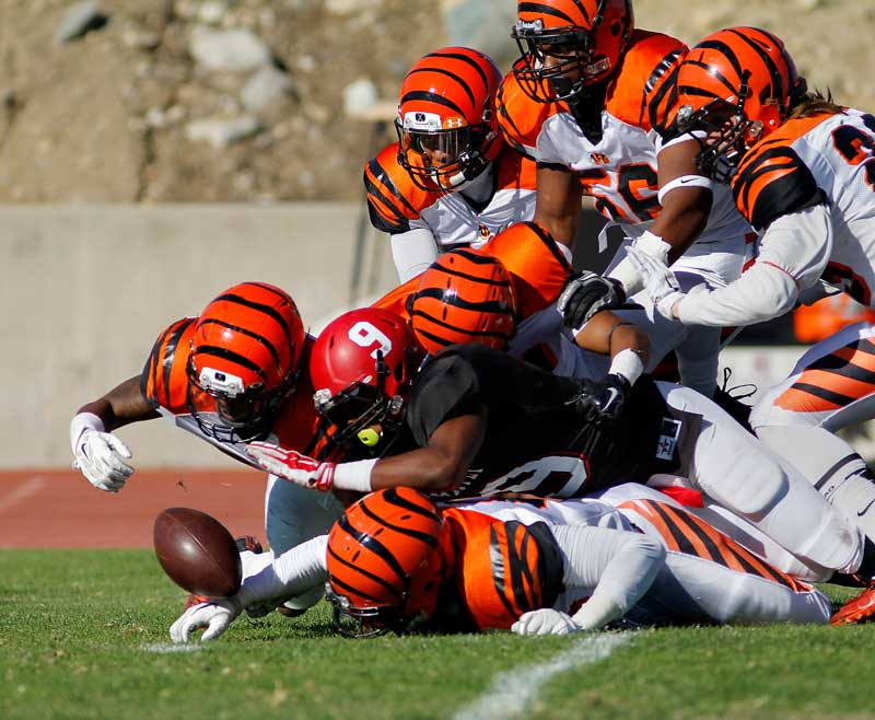 RCC defense forces a fumble by running back Cecil Fleming (9) in Chaffey's home game against Riverside City College on Nov. 8, 2014.
