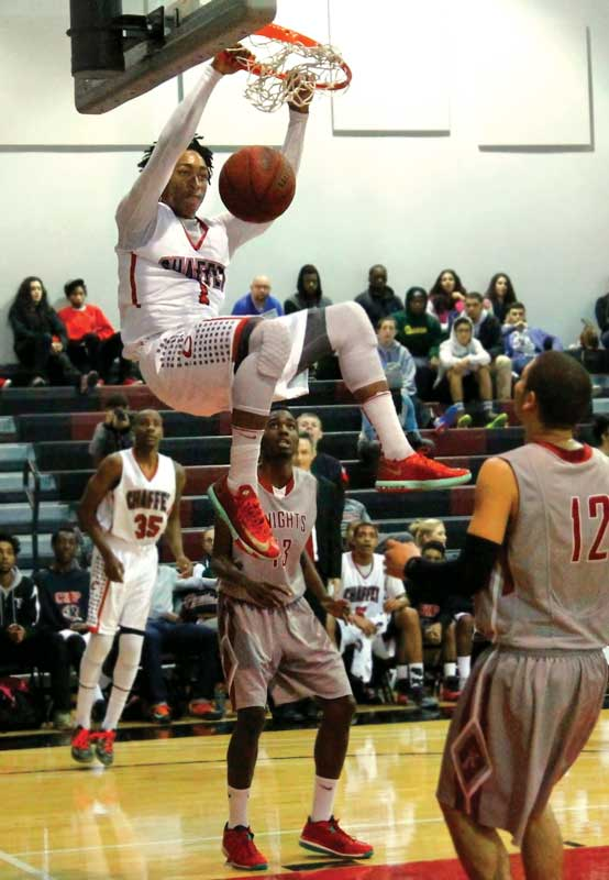 Adom Jacko dunks the ball in Chaffey's home game against San Diego City College on March 1, 2014.