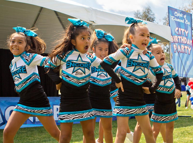 Encore Elite cheerleaders Mia Torres, Bella DeCases, Kayla Perez, Madison Balsz and Chloe Clyborne perform at Pantera Park in Diamond Bar, Calif. on Saturday April 12, 2014.  Their performance was part of the City of Diamond Bar's 25th Anniversary Celebration.