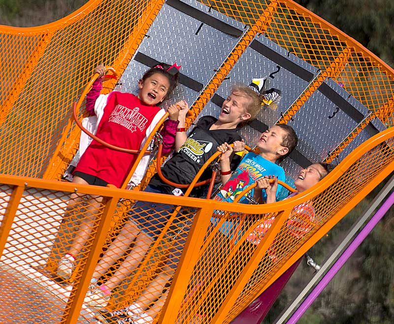Kayla Saiza, 8, Makayla Struble, 9, Jack Zepeda, 8, and Maya Zepeda, 10, enjoy the scat ride at Pantera Park in Diamond Bar, Calif. on Saturday, April 12, 2014. Carnival rides were brought in as part of an event to celebrate Diamond Bar's 25th anniversary.